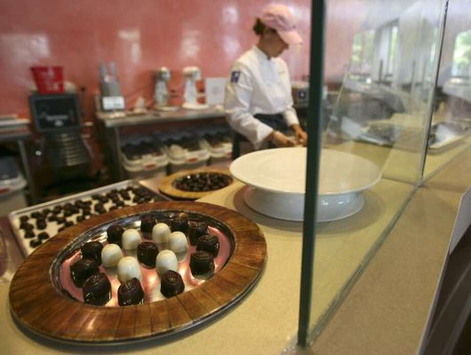 Colleen Hilker, executive pastry chef/baker, works in the kitchen of Chocolata Cocoa Bar, a dessert bar in The Woodlands that opens Saturday. Photo: KAREN WARREN PHOTOS, CHRONICLE