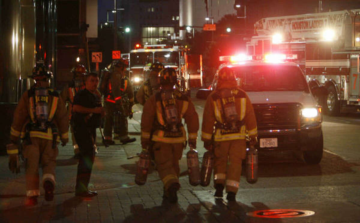 Firefighters battle a blaze on the 16th floor of a high-rise office building Tuesday evening at McKinney and Fannin in Houston.