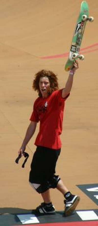 "Shaun White, ""The Flying Tomato,"" won his first gold in men's Skateboard Vert. Photo: RYAN PEARSON, ASSOCIATED PRESS"