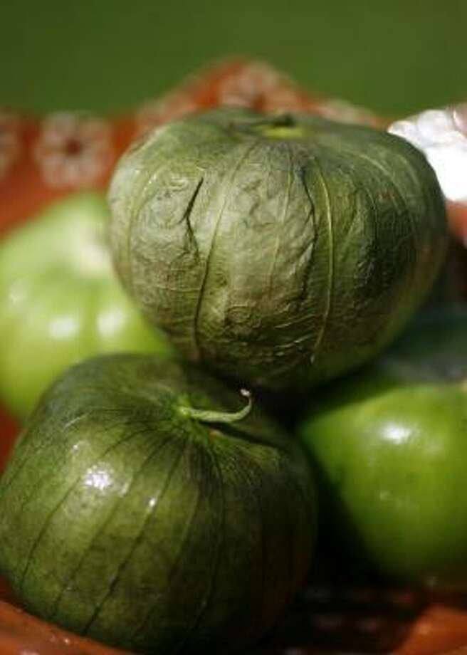 The tomatillo, a cousin of the tomato, is tart and aromatic. Photo: Sharon Steinmann, Chronicle