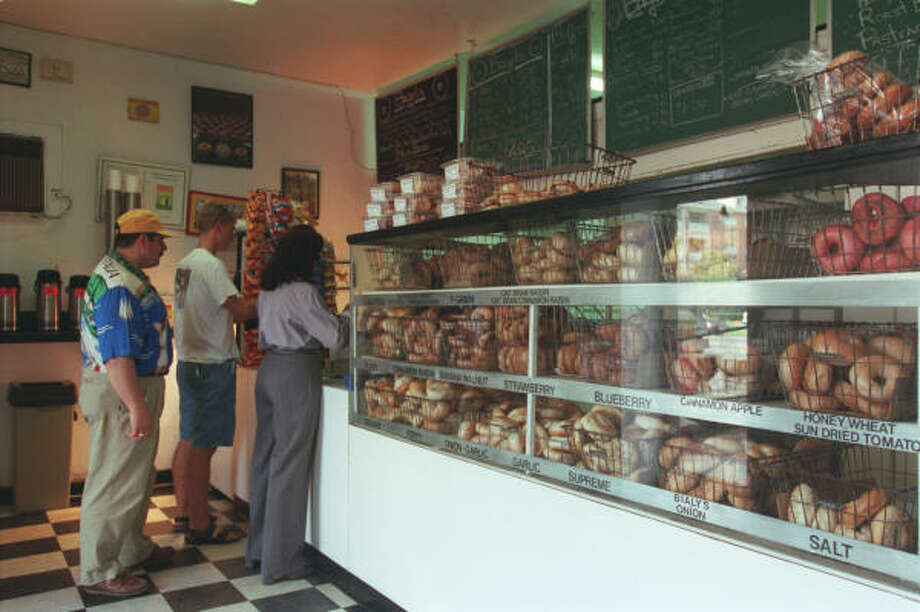 Customers line up for bagels in The Hot Bagel Shop. Photo: Chronicle File