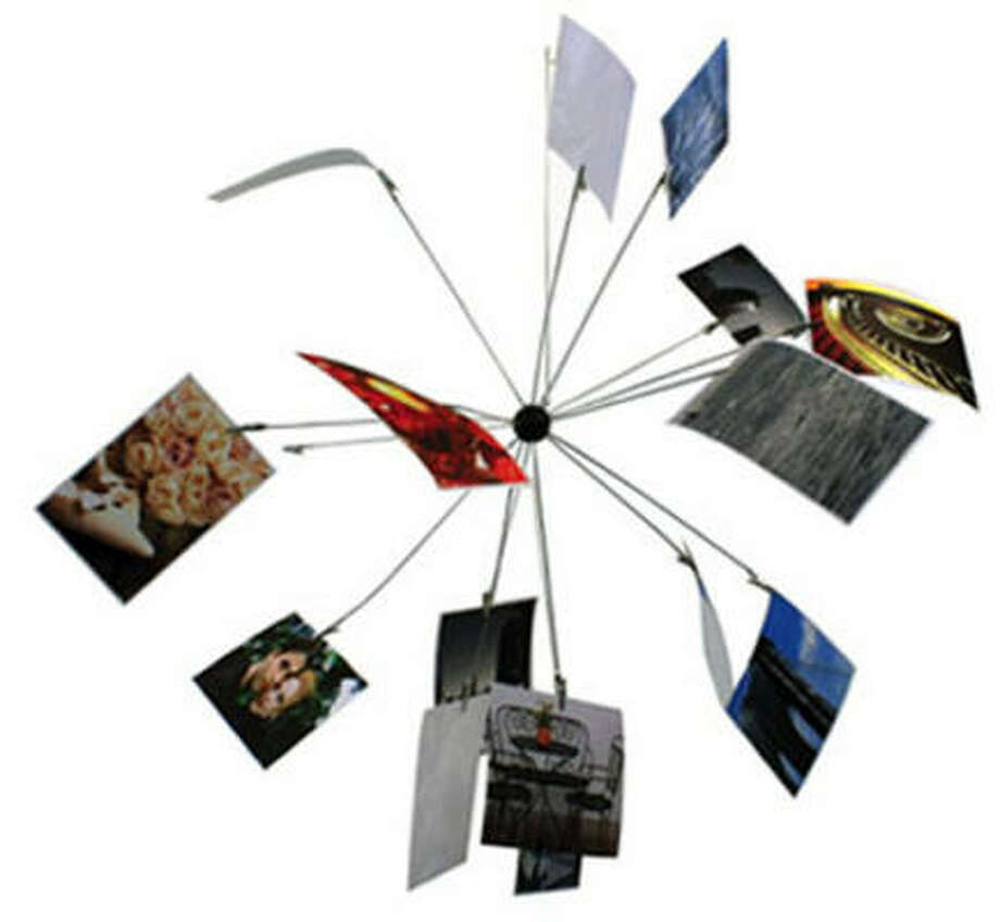 the Satellite Hanging Photo Holder is $9 at HIgh Fashion Home. Photo: High Fashion Home