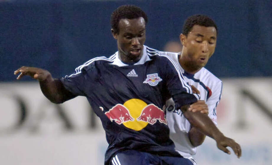 Red Bulls forward Francis Doe, front, and Revolution defender James Riley vie for possession during a 2-2 tie Saturday. Photo: Bill Kostroun, AP