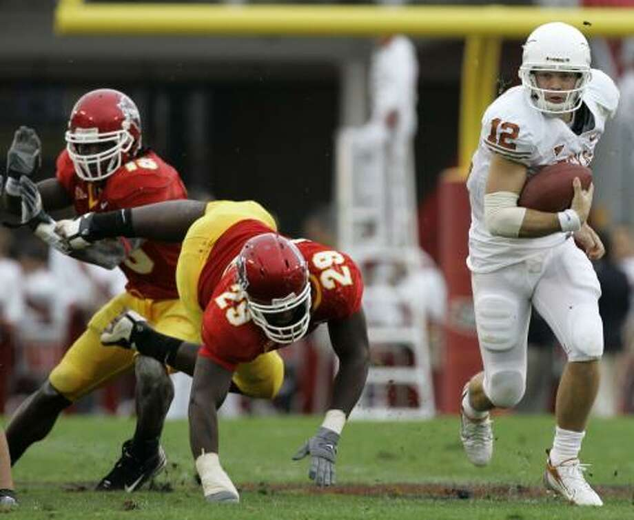 Quarterback Colt McCoy extends Texas' lead with a 44-yard touchdown run. Photo: CHARLIE NEIBERGALL, ASSOCIATED PRESS