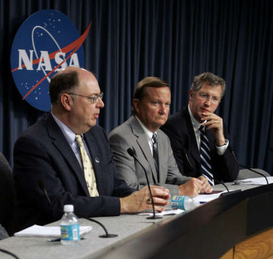 From left, space shuttle program manager Wayne Hale, space shuttle launch director Mike Leinbach, and NASA Engineering and Safety Center director Ralph Roe discuss the shuttle Discovery's flight readiness Tuesday. Photo: John Raoux, AP