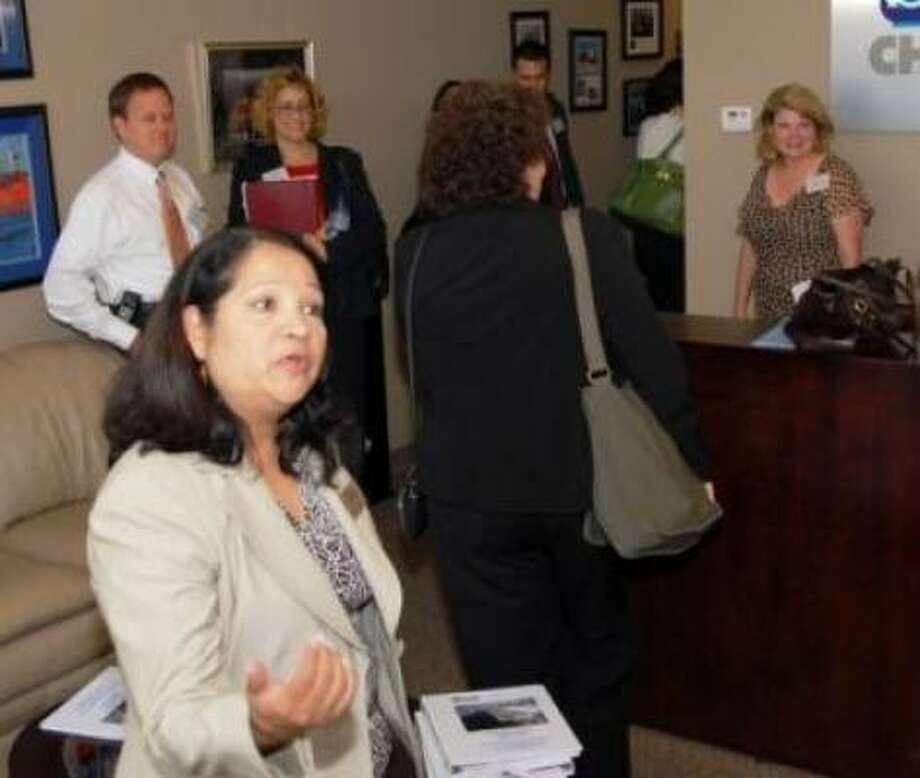 Houston East End Chamber of Commerce Director of Development Sylvia Medina greets visitors to the chamber's offices prior to embarking on a bus tour of the East End. Photo: Houston East End Chamber Of Commerce, Courtesy Photo