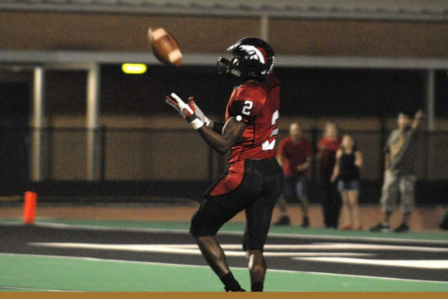 Ja-Mes Logan of Westfield is open for a touchdown against Klein Oak. Photo: Craig Prejean, For The Chronicle