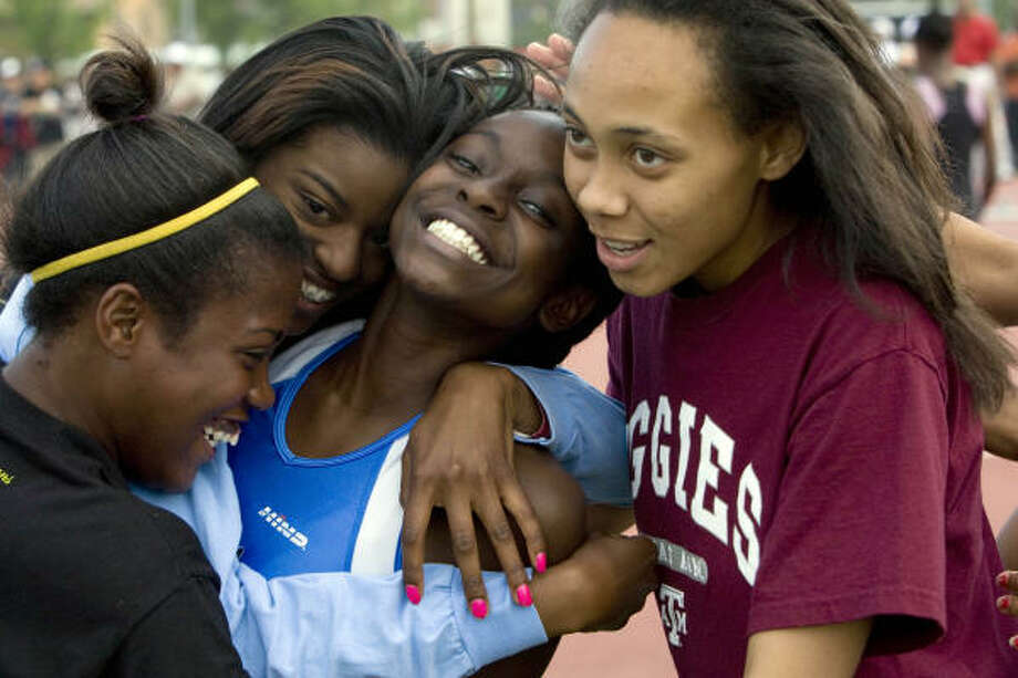 Westside's Diamond Dixon is congratulated by her teammates after she won the girls 400 meters at the 58th TSU Relays at Texas Southern University. Photo: Johnny Hanson, Chronicle