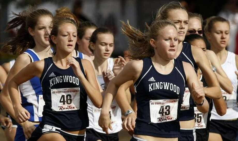 A runner-up finish by Kristen Hanselka, right, helped Kingwood capture the girls 5A title. At left is Addie Quinn (48) Photo: BRIAN K. DIGGS, FOR THE CHRONICLE