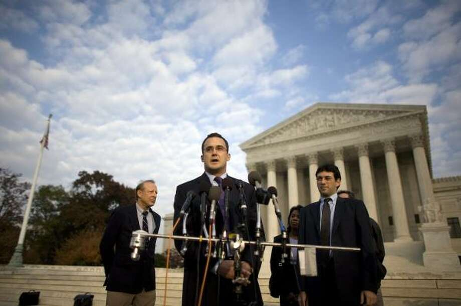 Lawyers Clark Neily III, center, and Alan Gura, right, came up with a strategy to get the case before the Supreme Court. Photo: CHUCK KENNEDY, McCLATCHY-TRIBUNE