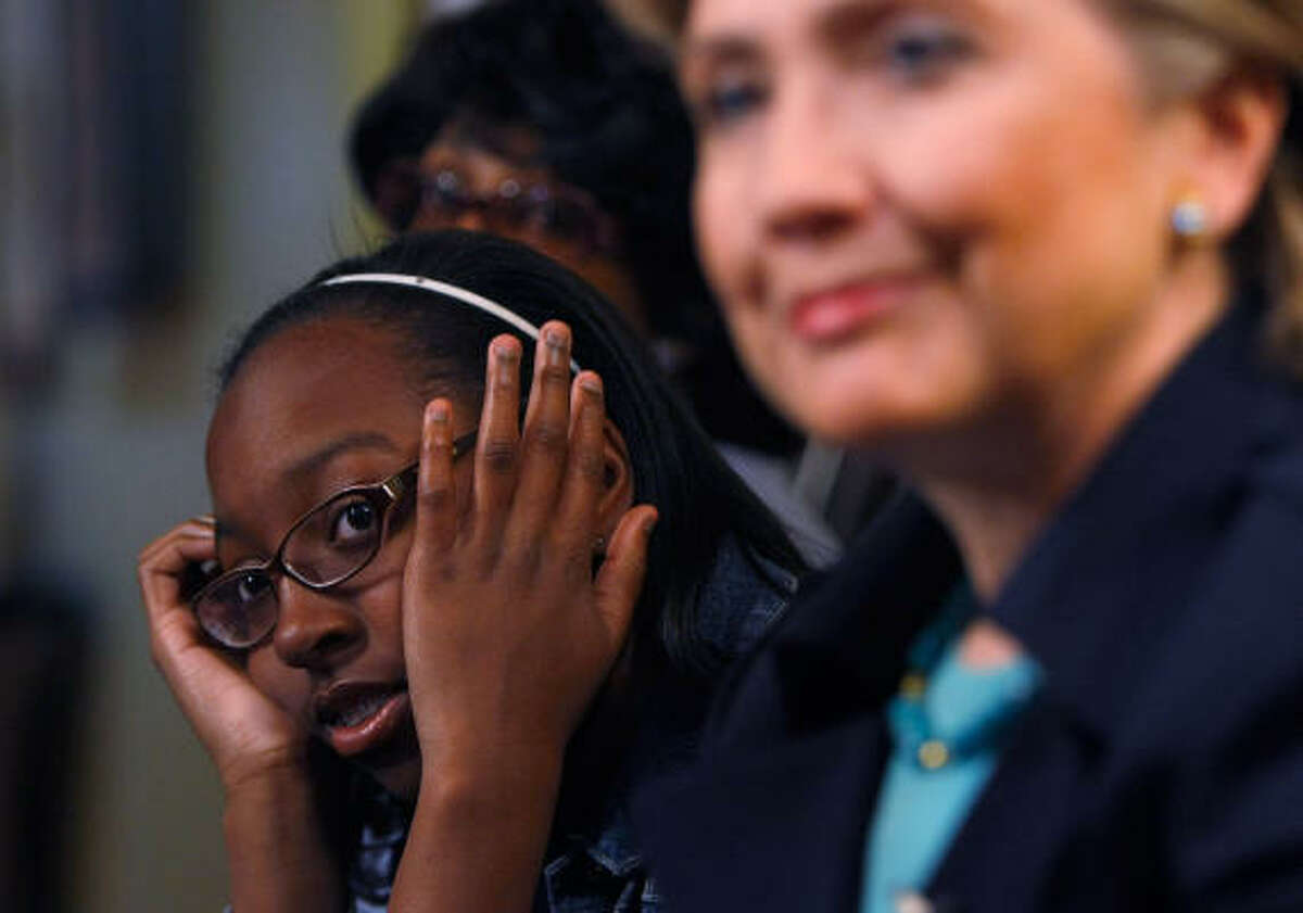 Da'Nelle Grier sneaks a peek at Hillary Clinton at a campaign event in Inglewood, Calif., on Saturday.