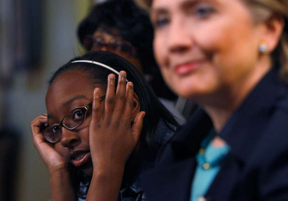 Da'Nelle Grier sneaks a peek at Hillary Clinton at a campaign event in Inglewood, Calif., on Saturday. Photo: Justin Sullivan, Getty Images