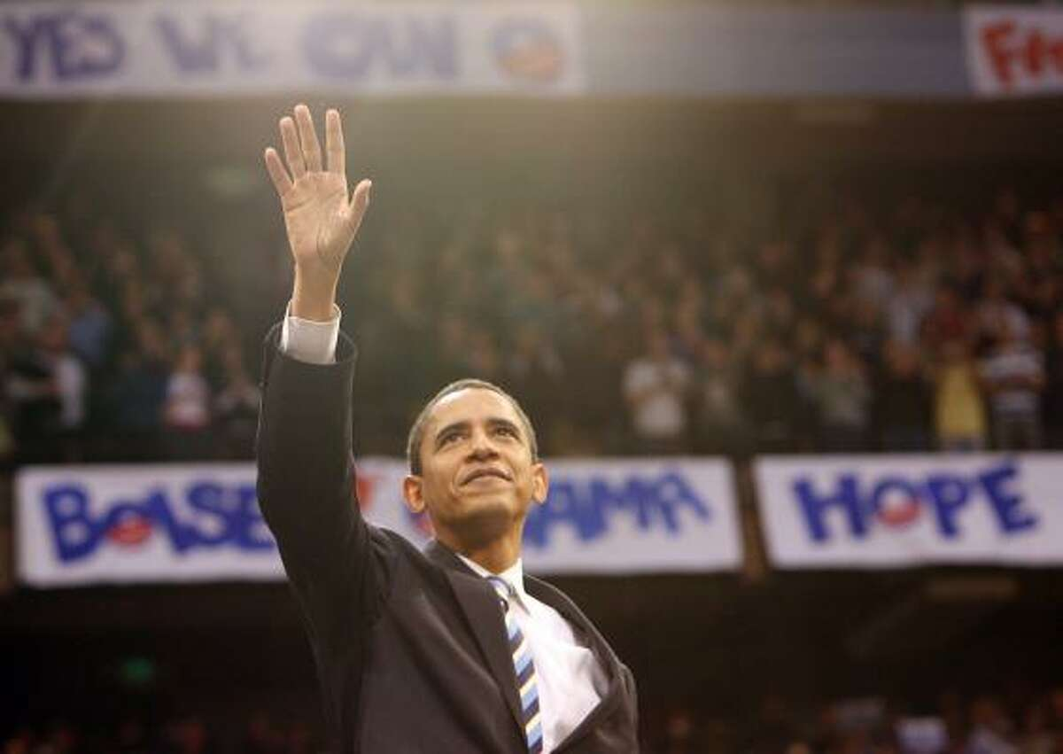 Barack Obama greets the crowd packing a Boise State arena in Idaho on Saturday.