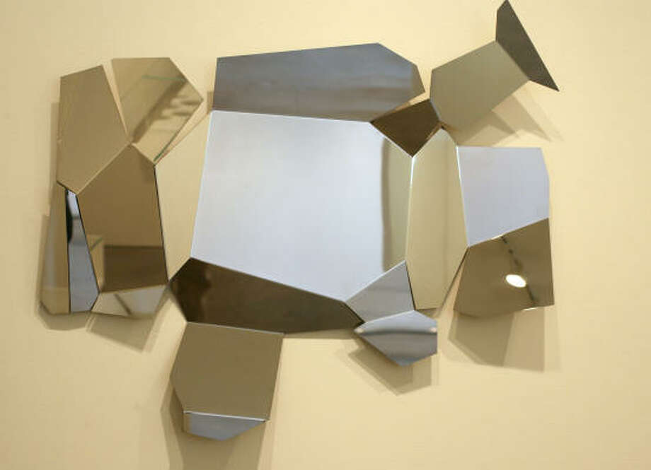 Arik Levy's Rock Mirror reflects the designer's artistic side. Photo: Sharon Steinmann, Chronicle