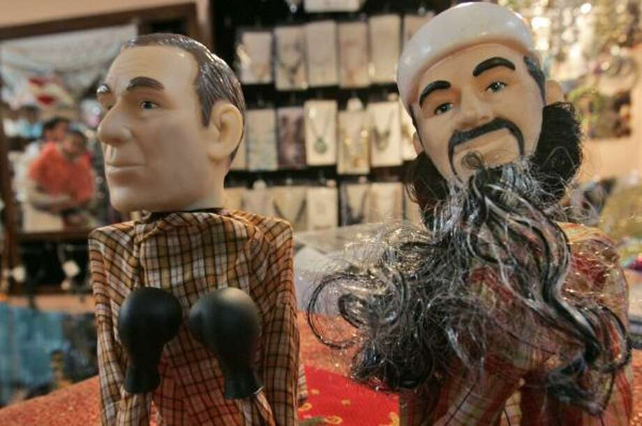 Despite souvenirs being readily available in Ramallah, Palestinians are staying cool toward Osama bin Laden. Photo: MUHAMMED MUHEISEN, ASSOCIATED PRESS FILE