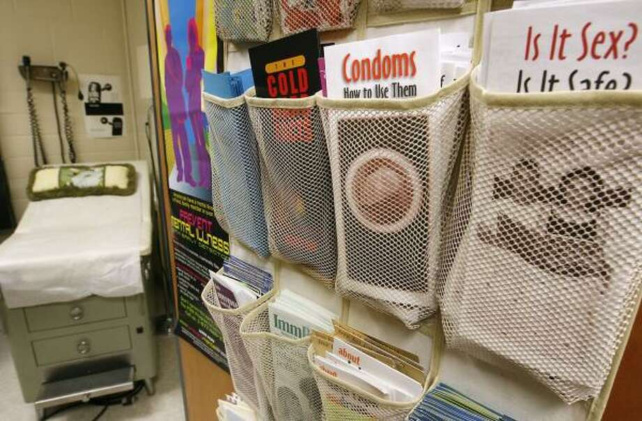 Pamphlets about safe sex line the door of the health clinic at King Middle School in Portland, Maine. Photo: CHERYL SENTER, ASSOCIATED PRESS
