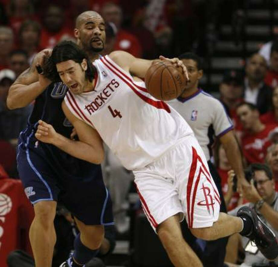 Rockets forward Luis Scola (right) drives the ball around the Jazz's Carlos Boozer during the first quarter. Photo: Brett Coomer, Chronicle