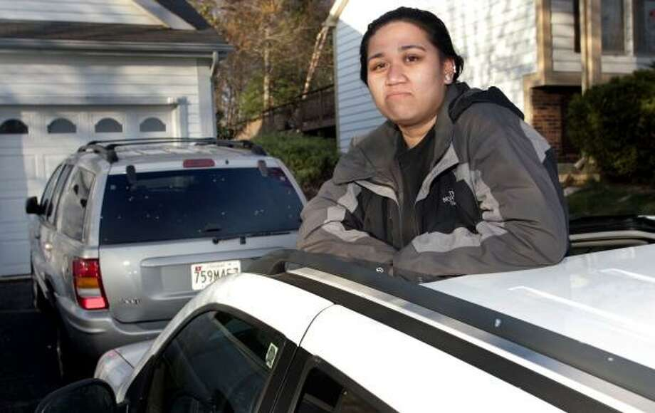 Paula San Gabriel stopped making payments on her used Jeep after it developed engine trouble. It sits in her driveway while she saves for repairs. Photo: MARK GAIL, WASHINGTON POST
