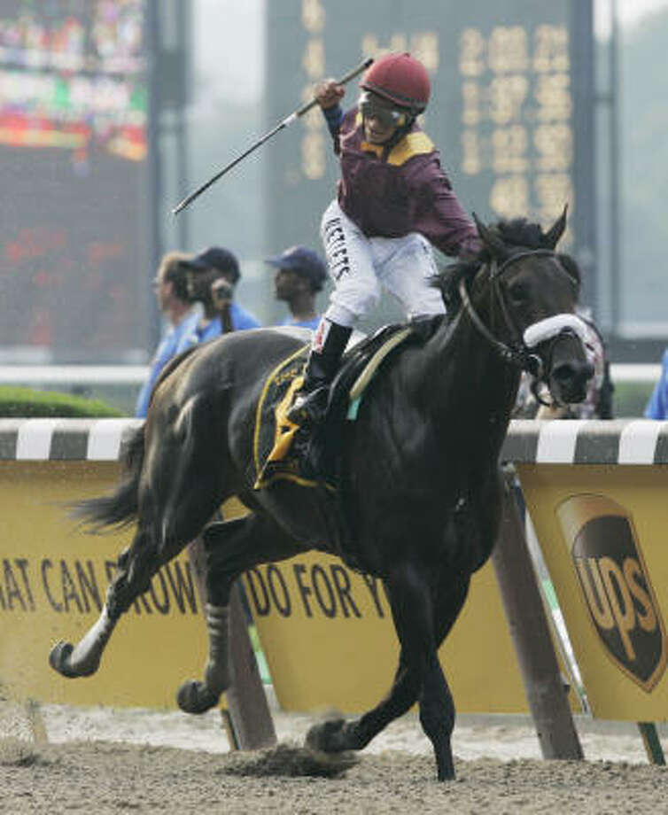 Da' Tara's jockey Alan Garcia celebrates as he approaches the finish line to win the Belmont. Triple Crown hopeful Big Brown finished last. Photo: Denis Paquin, AP