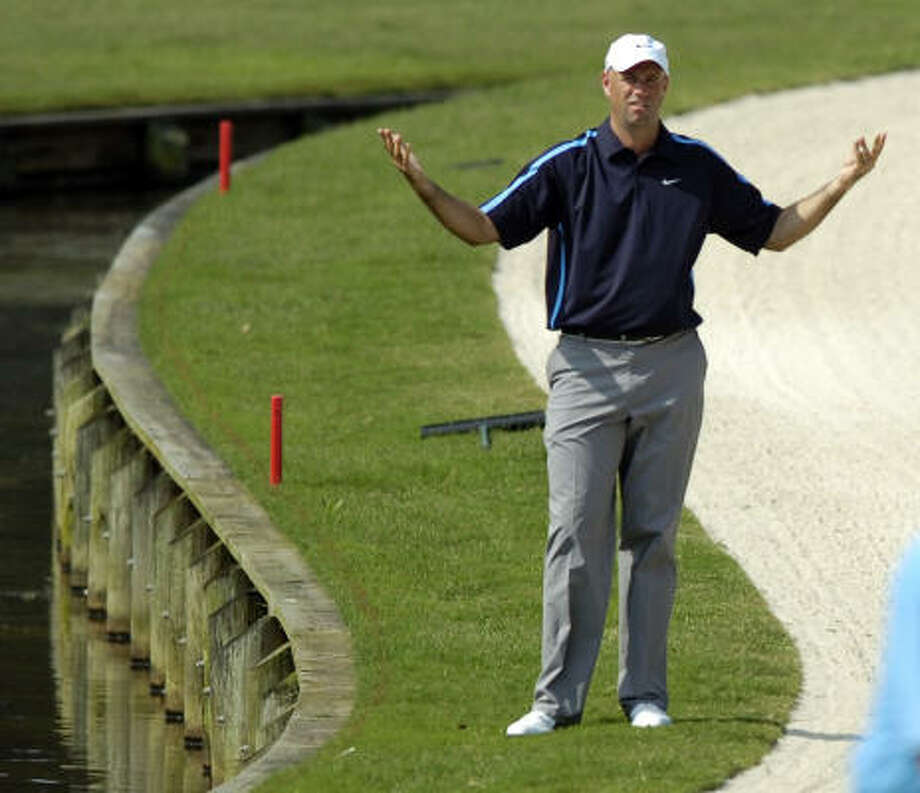 Stewart Cink (here at the water hazard at No. 11) is tied for 23rd at 1 under. Photo: Stephen Morton, AP