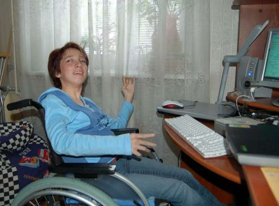 Vera Samykina, with cerebral palsy, is an A student who studies at home in Russia. She eyes college despite her challenges. Photo: PETER FINN, WASHINGTON POST