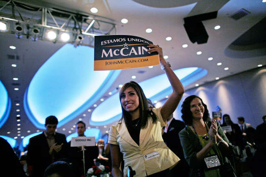 Supporters of Republican John McCain wave Spanish-language campaign signs during the national convention of the League of United Latin American Citizens in Washington on Tuesday. Photo: Chip Somodevilla, Getty Images