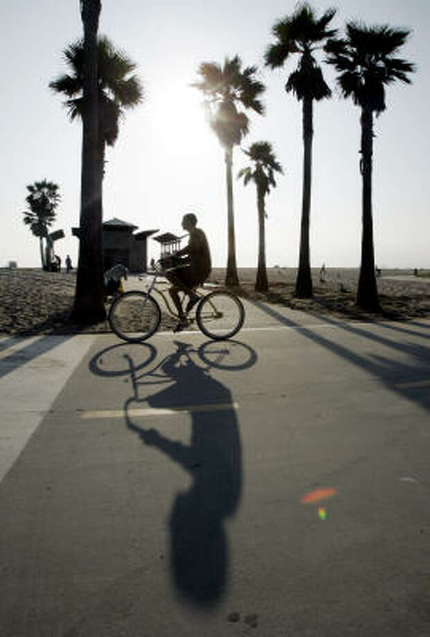 The boardwalk in the Venice beach area. Photo: REED SAXON, Associated Press