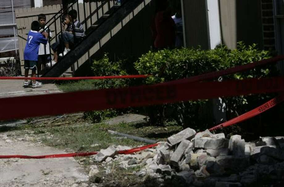 The city hired an engineering firm to determine the cause of a stairway collapse at the Westwood Fountains Apartments on July 16. Two children were killed and one was injured in the collapse. Photo: JULIO CORTEZ, CHRONICLE