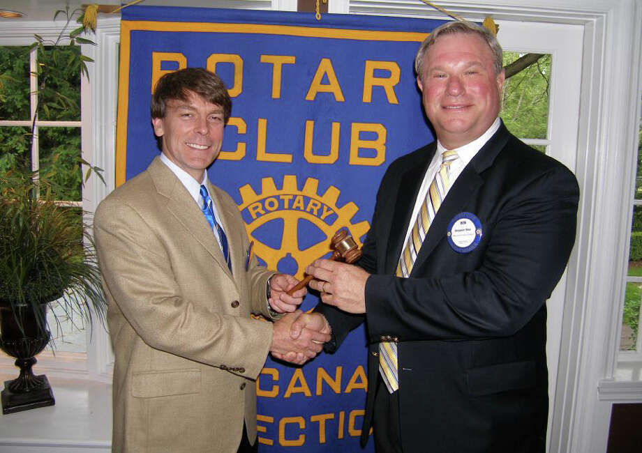 New Canaan Rotarians gathered recently at the Roger Sherman Inn, where outgoing President Scott Hobbs (left) passed on the gavel to President-Elect Ben Bilus. Photo: Contributed Photo