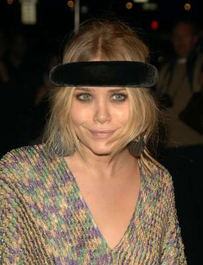 Mary-Kate Olsen has tried the halo-headband look even for nighttime parties. Photo: Peter Kramer, Associated Press