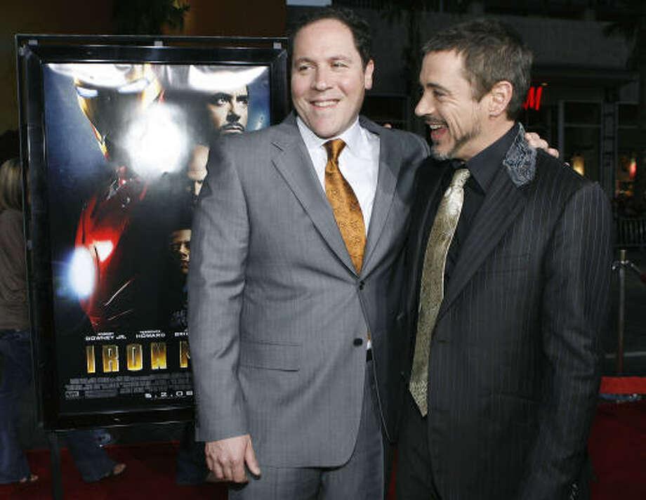 """Iron Man"" director Jon Favreau, left, is returning to direct Robert Downey Jr. in ""Iron Man 2"". He'll also serve as executive producer on ""The Avengers"". Photo: Matt Sayles, Associated Press"