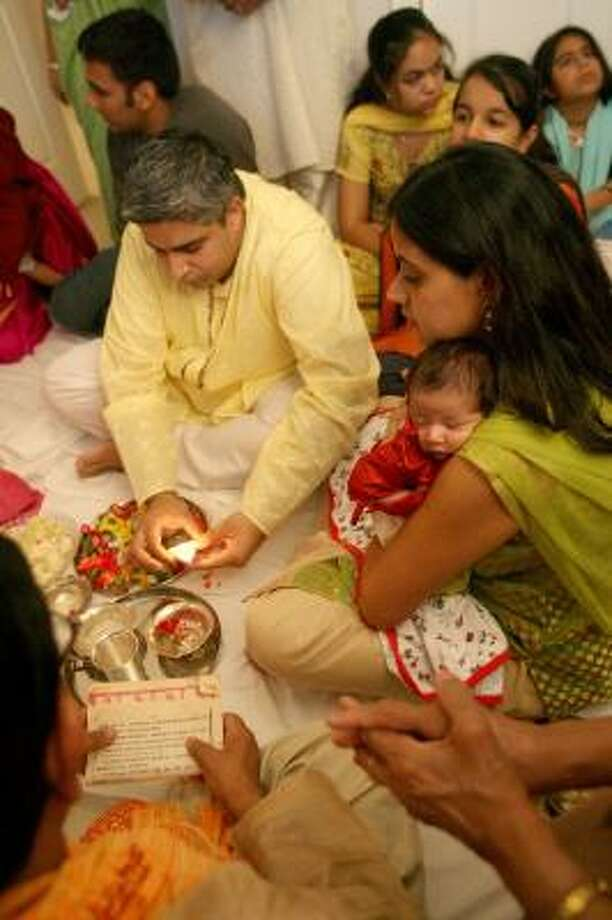 """The Mehras, first-generation Americans, plan to observe Diwali with variations. """"We're interpreting our existence differently, but I think that's true for all children of immigrants,"""" Maneesh Mehra said. Photo: BILL OLIVE, FOR THE CHRONICLE"""