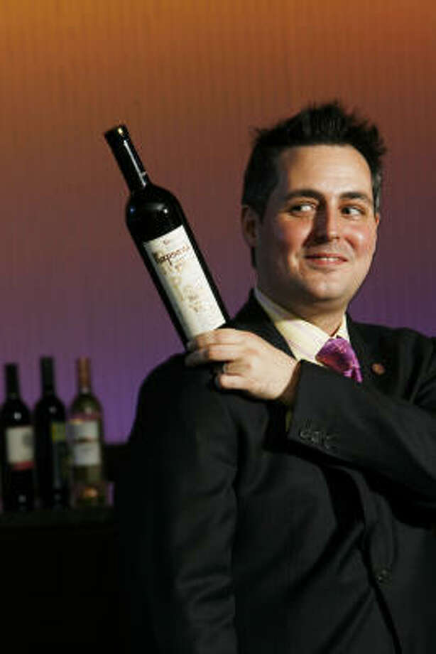 Evan Turner, Sommelier at restaurant 17 in the Alden hotel, holds a bottle of Rapsani, a Greek red-wine blend. Photo: ERIC KAYNE:, CHRONICLE