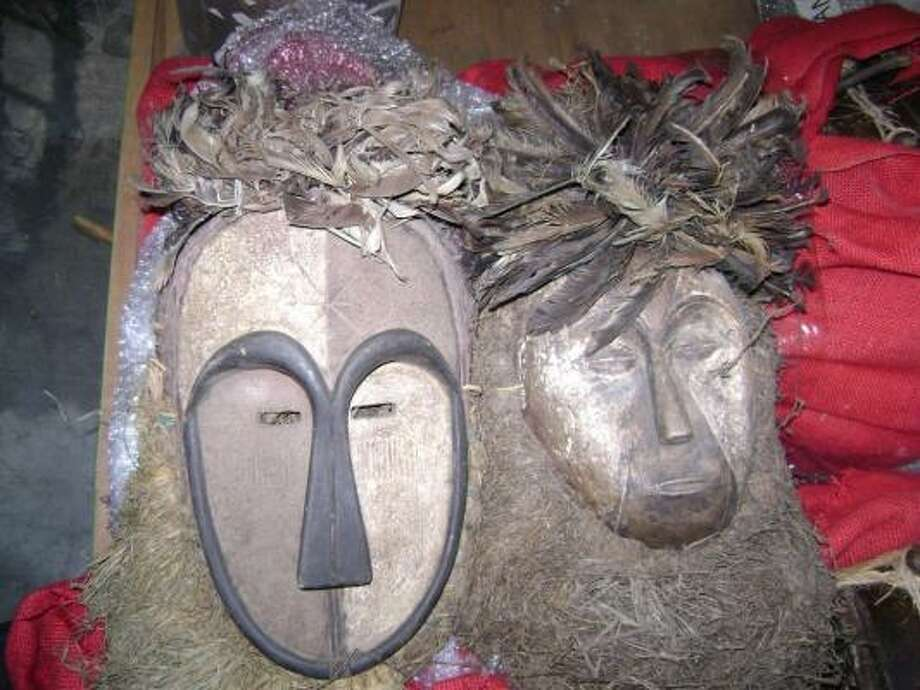 Customs agents say termites were discovered in these wooden masks, which also contain contaminated bird feathers. Photo: U.S. Customs And Border Protection