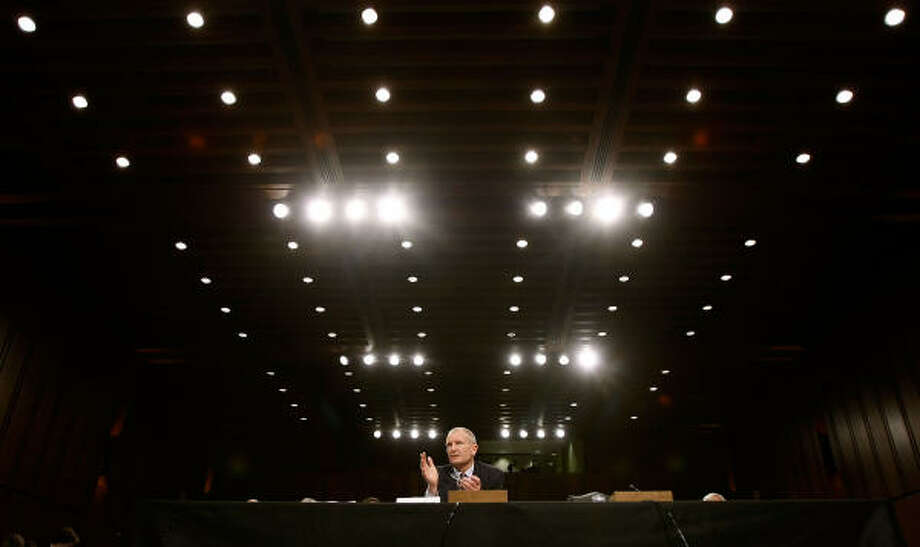 WARNING: Dennis Blair tells a Senate panel the current crisis could cause governments to collapse. Photo: Chip Somodevilla, Getty Images