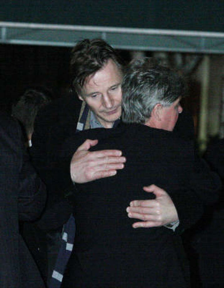 Liam Neeson, left, embraces an unidentified man after exiting the American Irish Historical Society where the body of Neeson's wife, Natasha Richardson, was lying in repose Friday  in New York.  Richardson died Wednesday after suffering a head injury while at a Canadian ski resort. Photo: Tina Fineberg, AP