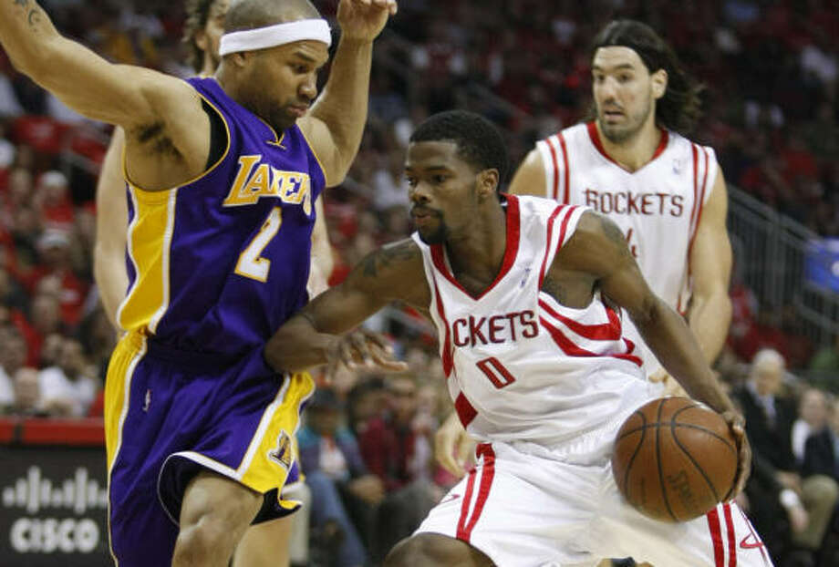 The Lakers had major problems stopping the penetration of Aaron Brooks and the Rockets in Game 4. Photo: Brett Coomer, Chronicle