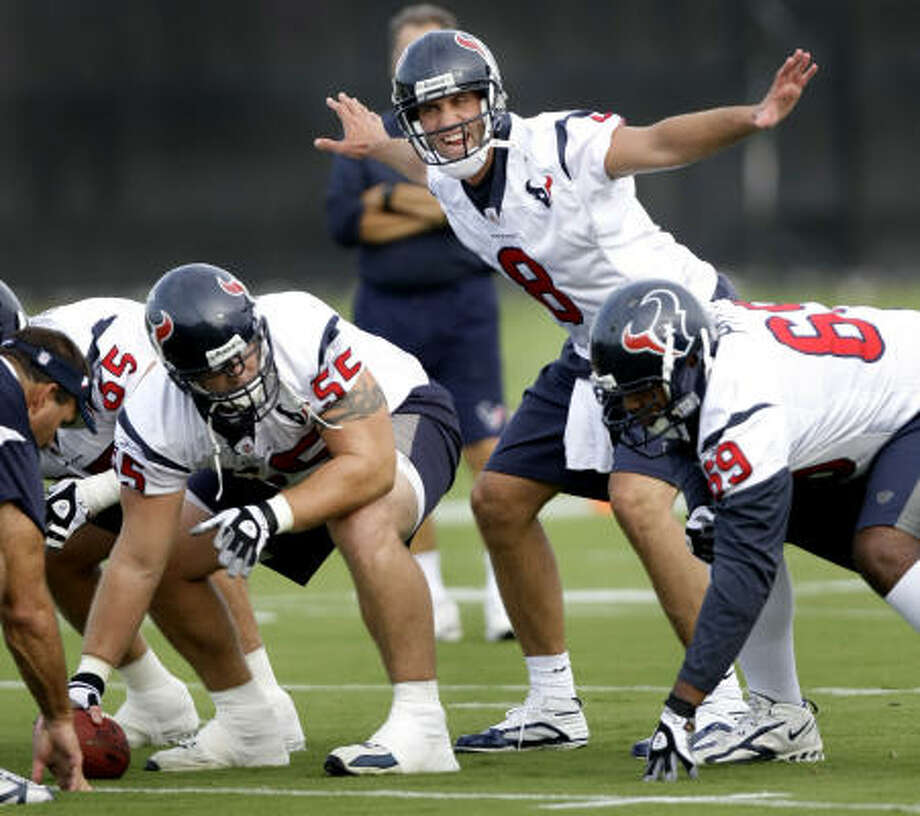 Texans quarterback Matt Schaub (8) calls a play as he lines up behind center Chris Myers (55) and guard Chester Pitts (69) during the opening practice of Texans training camp Friday. Photo: Brett Coomer, Chronicle