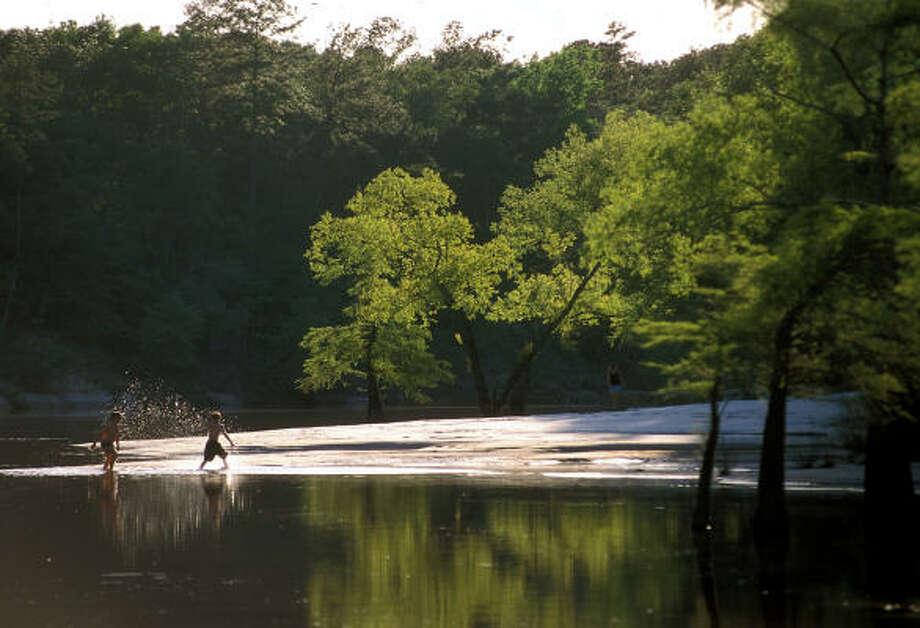 The sandbar swimming hole at Village Creek State Park near Lumberton in southeast Texas was named one of the Top 25 swimming holes in Texas in 2008 by Texas Monthly magazine. Photo: EARL NOTTINGHAM, TEXAS PARKS & WILDLIFE
