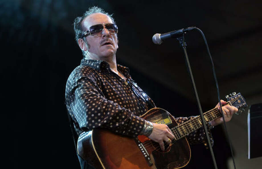 Elvis Costello is a good selection for a dinner party. Photo: DAVE MARTIN, ASSOCIATED PRESS