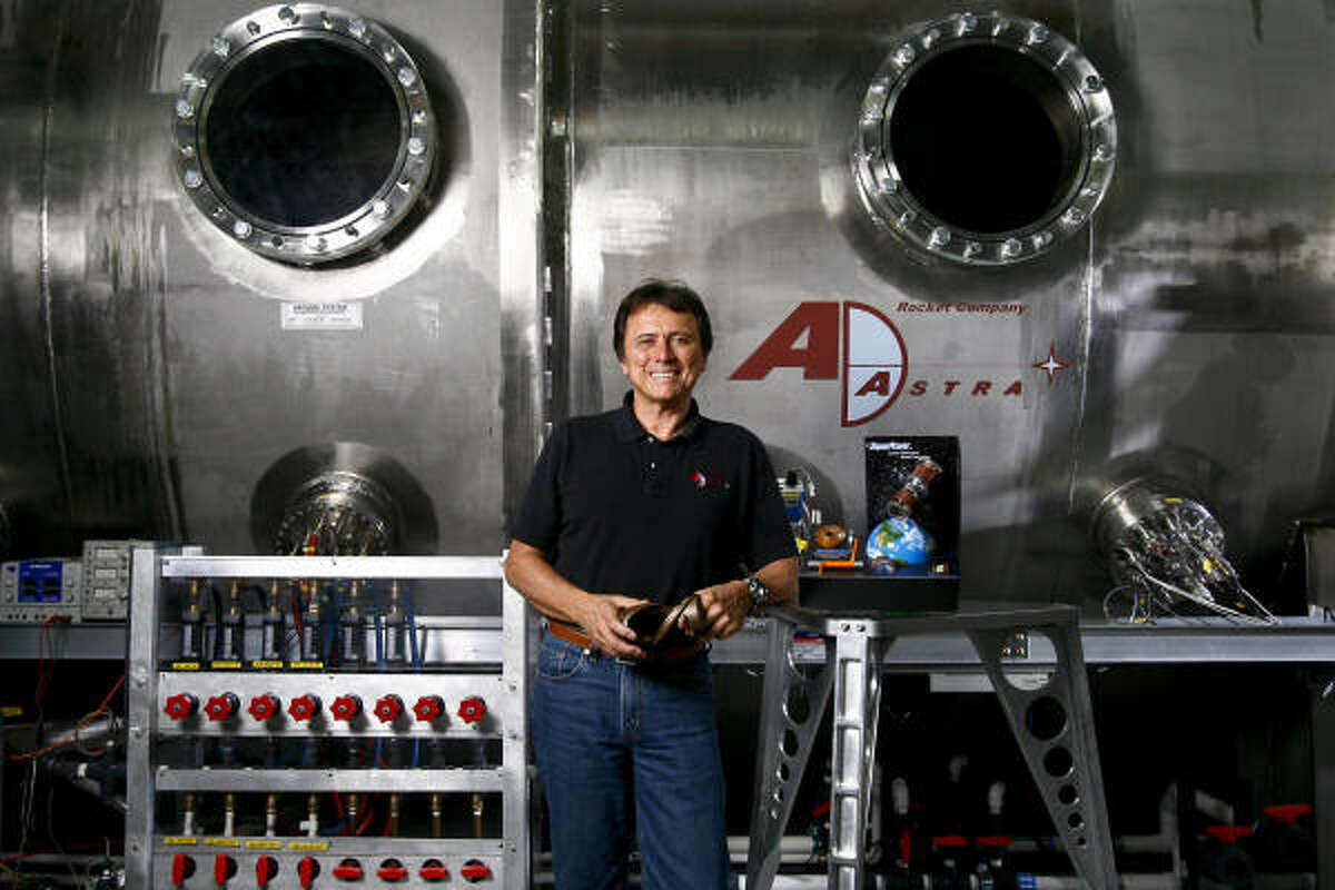 Franklin Chang-Diaz with the vacuum chamber that holds his plasma rocket. The technology, which he developed at NASA, could one day get humans to Mars in 39 days.