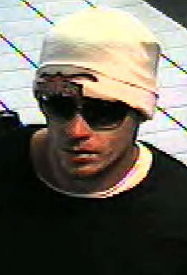 The man in this image, taken from surveillance video, reportedly robbed the Smart Financial Credit Union in Kingwood. Photo: FBI