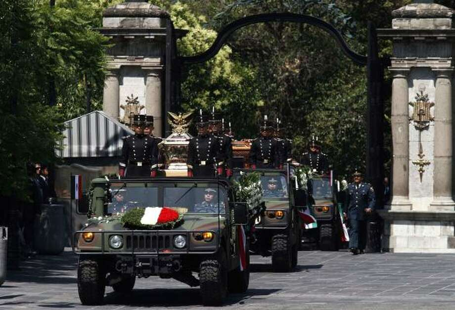 "Mexico's soldiers escort the bones of national heroes to the ""Castle of Chapultepec"" in Mexico City. Photo: Claudio Cruz, AP"