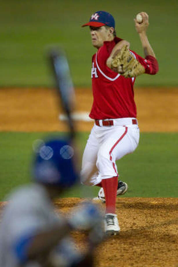 UH pitcher Chase Dempsay fires a pitch to Memphis' Adam McClain during the eighth inning. Photo: Smiley N. Pool, Chronicle