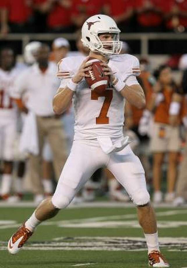 Longhorns quarterback Garrett Gilbert passed his first big road test on Saturday night. Photo: Ronald Martinez, Getty Images