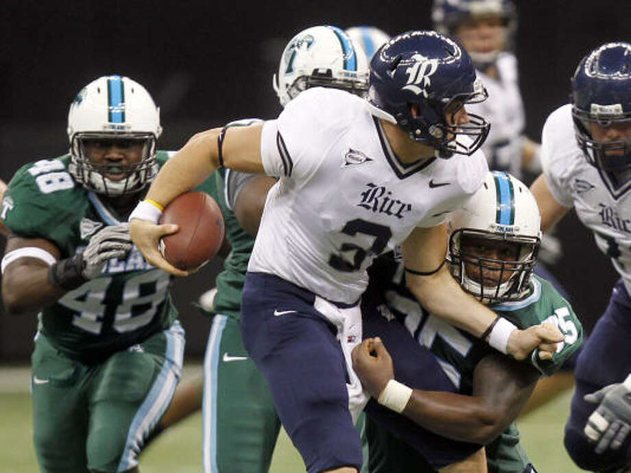 Rice quarterback Taylor Cook is sacked by Tulane defensive tackle Justin Adams (95) during Saturday's loss. Photo: Michael DeMocker, AP
