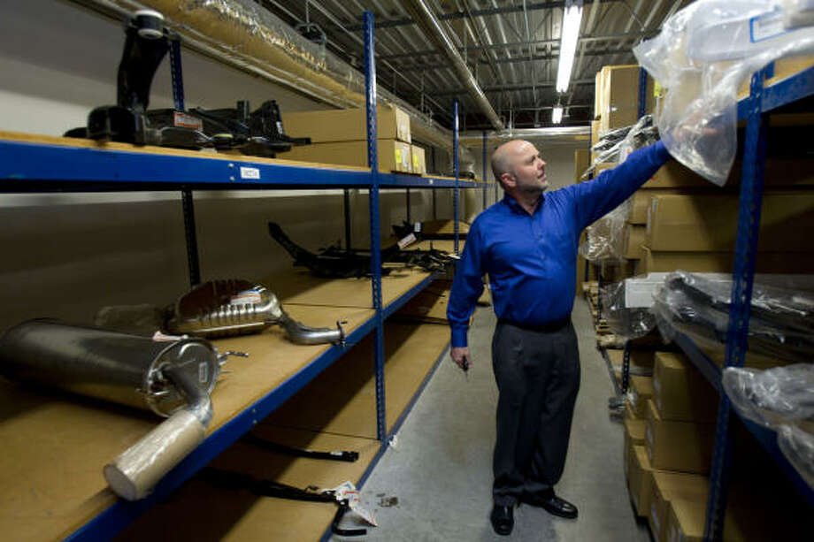 Steve Halbert, parts manager for Russell & Smith Auto Group, looks though Mazda parts at the company's Mazda dealership. He said emails have been sent out to order more parts than usual because of concerns about shortages. Photo: Johnny Hanson:, Chronicle