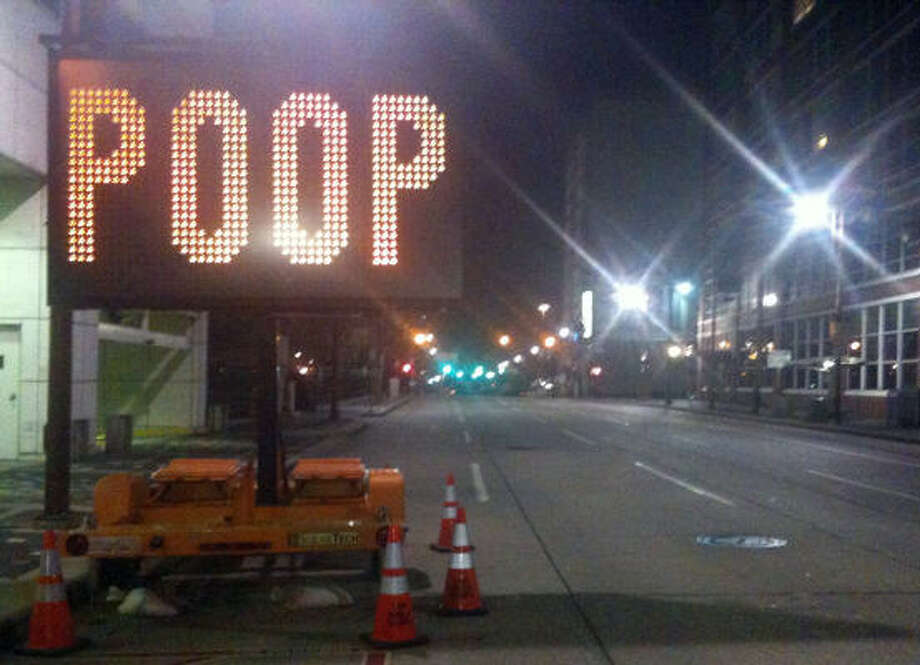 In recent days the traffic sign located at Louisiana and Prairie had been changed twice. Photo: J.R. Gonzales, Houston Chronicle