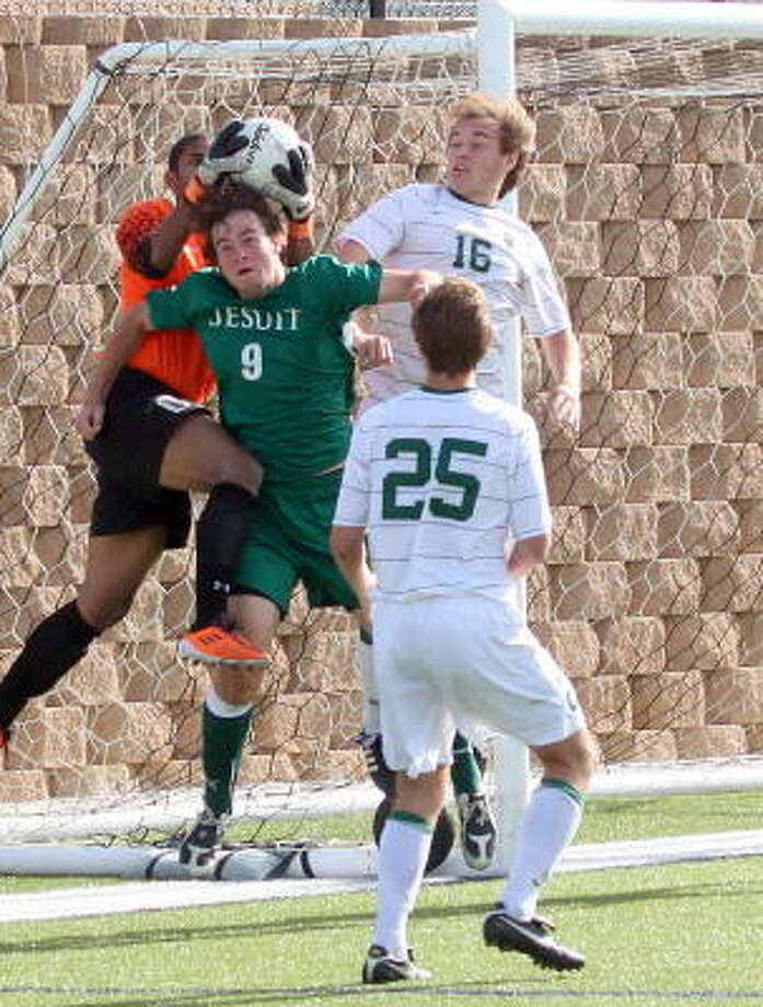 Strake Jesuit's Beck DeSpain has the ball taken off of his head by the goalkeeper on a corner kick Friday. Photo: GERALD JAMES, For The Chronicle