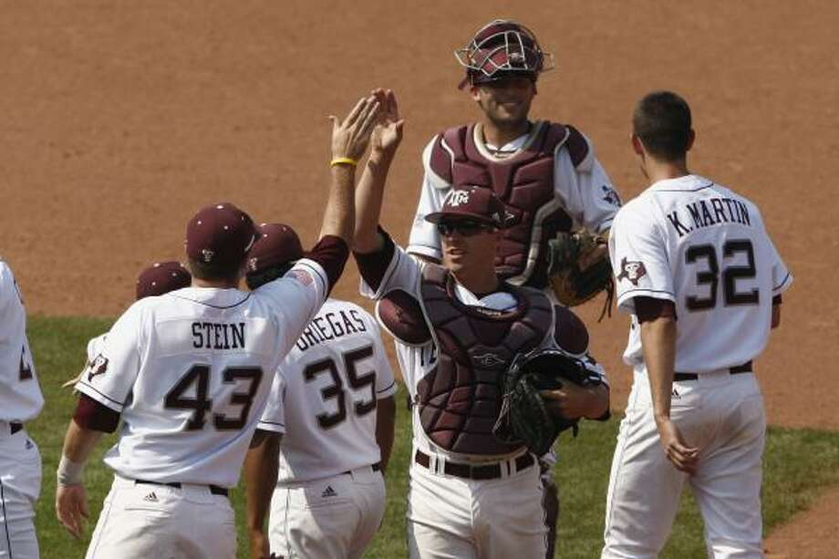 The Aggies, celebrating a win in Oklahoma City, rallied from an 8-4 deficit to earn the win. Photo: Alonzo Adams, Associated Press